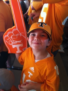 Noah with his foam finger at the UT v. Arkansas State game