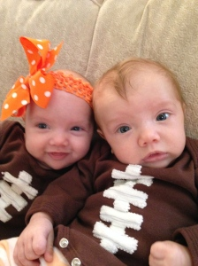 Twins in their football onesies