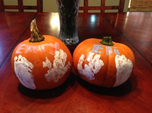 We painted E & E's pumpkins with their hand and foot prints