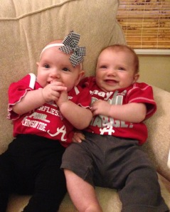 The babies in their crimson onesies from Nana and Papa
