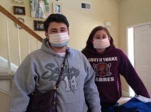 Dalton and Savannah preparing to ride home to NC with Papa and Nana-- yep, those are surgical masks.